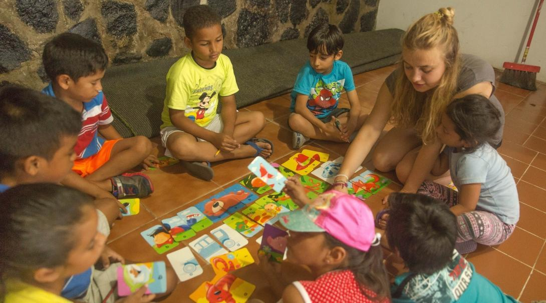 Flashcards are used to teach the children English words at one of our volunteer teaching placements in Ecuador